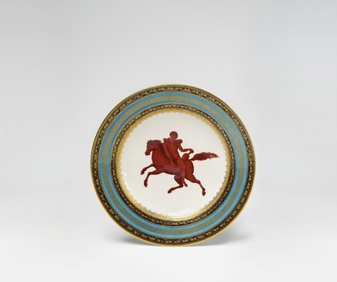 A Vienna porcelain plate with a red horseman -