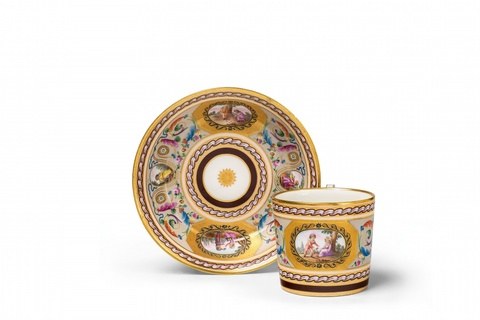 A Vienna porcelain cup and saucer with grotesques -