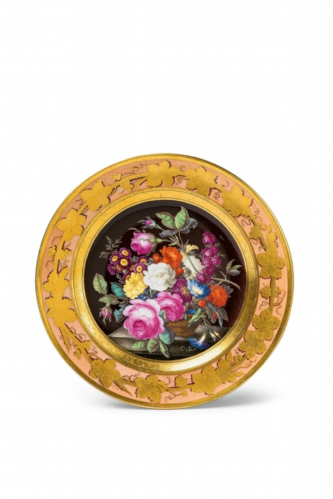 A Berlin KPM porcelain plate with a basket of flowers -