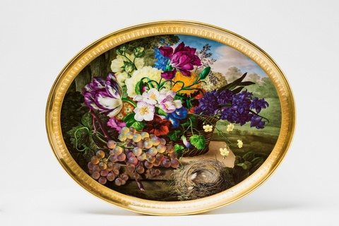 A Vienna porcelain tray with a basket of flowers, grapes, and a bird's nest -