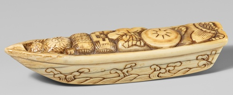 An ivory netsuke of a boat filled with takaramono. First half 19th century -