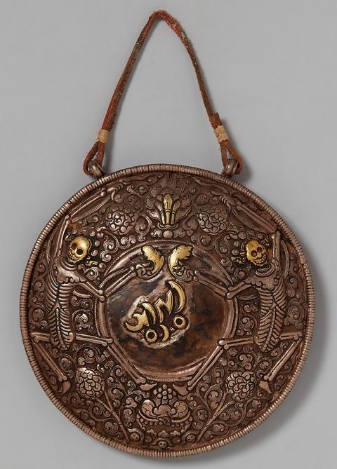A Tibetan silver oracle mirror -