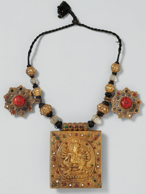 A precious gilt silver amulet with coloured stones and necklace from Kathmandu Valley, Nepal -