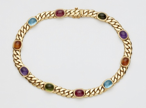 An 18k gold and coloured gemstone necklace -