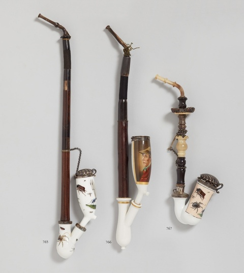 A porcelain pipe with insect decor -