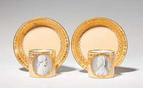 An important pair of Vienna porcelain cups with a double portrait -