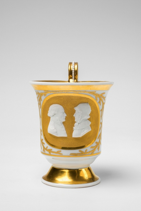 A Berlin KPM porcelain cup with relief portraits of Friedrich Philipp Rosenstiel and his wife -