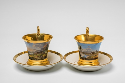 A pair of Nymphenburg porcelain cups with views of Bavaria -