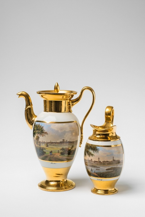 Two Nymphenburg porcelain pitchers with views of Munich and Neuburg -