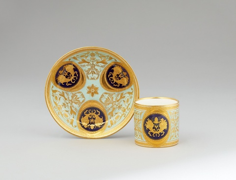 A Vienna porcelain cup and saucer with gold cornucopia motifs -