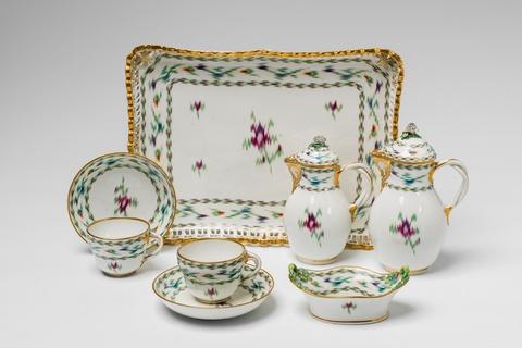 A Vienna porcelain tête à tête with Atlas decor -