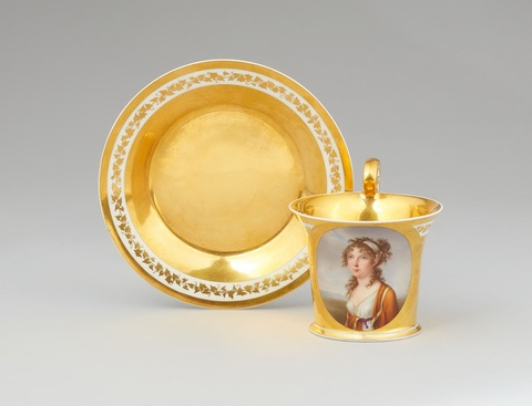A Vienna porcelain cup and saucer with a portrait of a young lady -