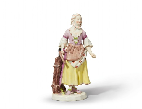 A Vienna porcelain figure of a girl carrying wood -