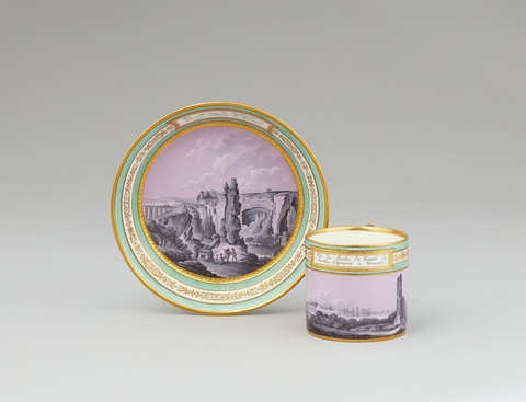 A Vienna porcelain cup and saucer with views of Syracuse -