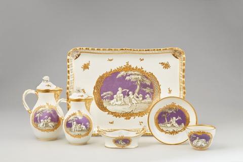 A Vienna porcelain dejeuner with children en grisaille on lilac ground -