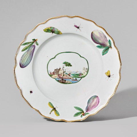 A Nymphenburg porcelain plate with a landscape and figs -