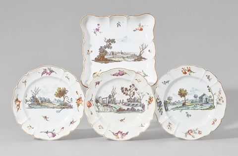 A Nymphenburg porcelain dish and three plates with green landscapes -