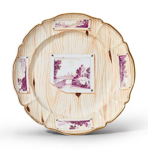 A Nymphenburg porcelain platter with a quodlibet -