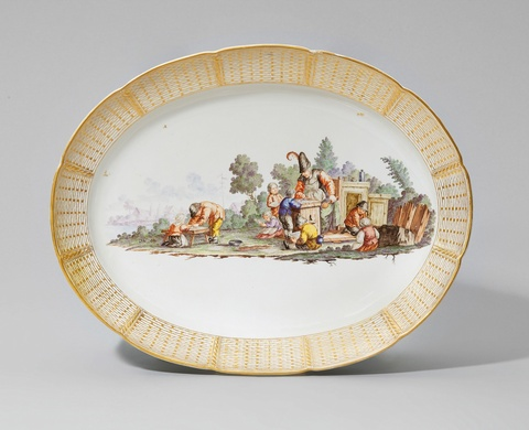 An oval Nymphenburg porcelain plaque with a peasant scene -