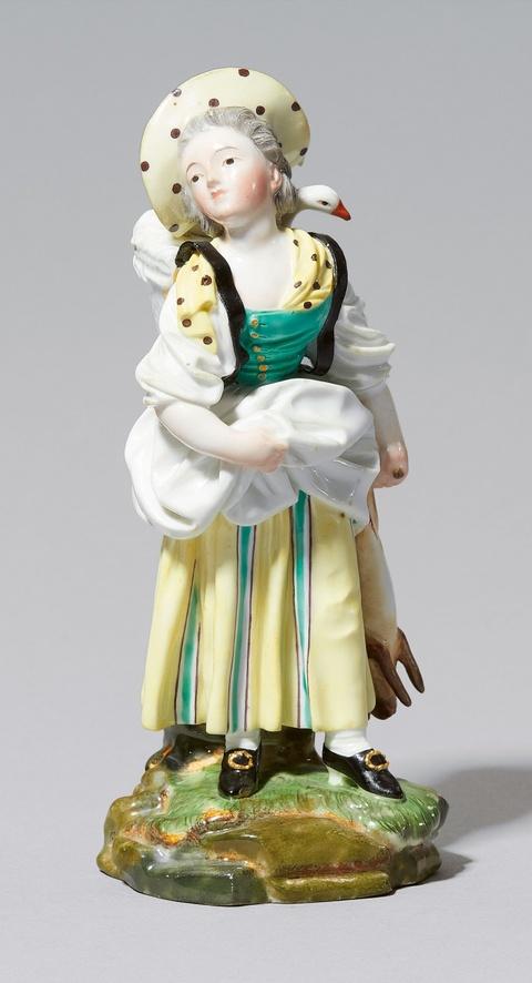 A Höchst porcelain figure of a poultry seller -