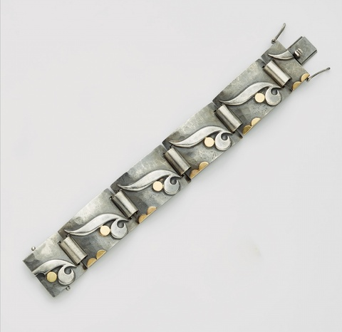 A silver and gold Art Deco bracelet -