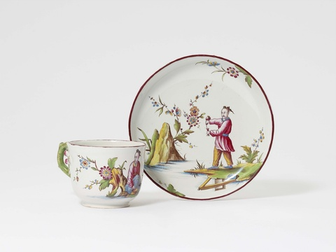 A rare Höchst faience cup and saucer with Chinoiserie decor -